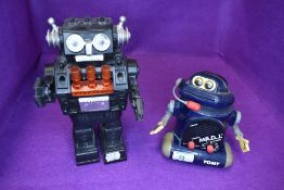 Two childrens toy robots one Hong Kong made and similar Tomy MR D.J