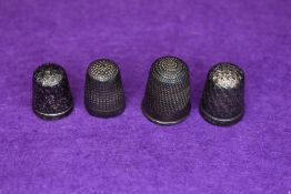 Four HM silver thimbles of various designs