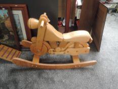 A child's modern wooden model Motorbike on rocking base, length 100cm, height 60cm