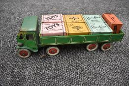 A 1940's Mettoy tin plate and clockwork TMC 8 wheel Wagon and Trailer in green with yellow