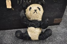 A mid 20th century straw filled Panda Bear having stitched nose and mouth, stitched boy with movable