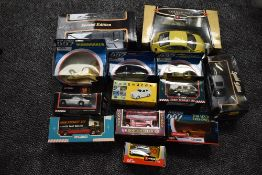 A selection of modern diecasts including Burago 1:18 scale Beetle, Maisto 1:18 scale Lamborghini,