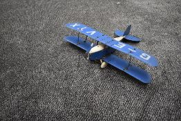 A Meccano hand built model Bi-Plane, G-EVTX in blue and white with pilot