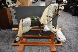 A modern traditional style Rocking horse made by Ron Wood of Lancaster, in dapple grey with green
