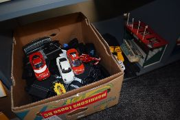 A shelf of moden Scalextric track, cars and controllers along with a empty early box C-82 Lotus