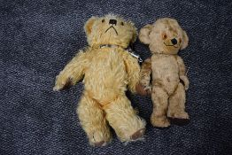 Two mid 20th century straw filled, yellow plush jointed Teddy Bears, Merrythought having plastic