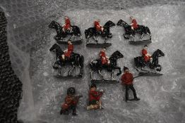 Six Lead flat figures, Black Horse with Rider wearing red jacket, all on base stand along with three