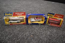 A Corgi diecast, James Bond Aston Martin in silver with red interior with driver, bandit and spare