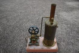 A well engineered Single Cylinder vertical live steam model Mill Engine having spoked flywheel,
