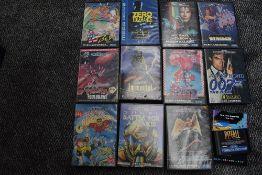 A Sega 16 Bit Mega Drive Console with 12 game cartridges, Sonic 2 no manual, VJ Boy, Zero Tolerance,