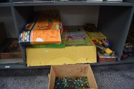 A shelf of vintage Toys and Games including Tudor Rose Table Top Soccer, Sharon See Jed Indian