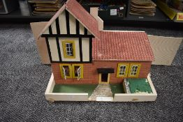 A hand made wooden Dolls House having two downstairs rooms and one bedroom along with hand made