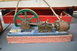 A Single Cylinder horizontal live steam model Mill Engine having spoked flywheel on wood base,