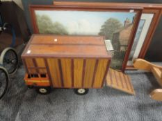 A 1960's Triang style plastic and wooden converted Horse Box having Britains and similar plastic