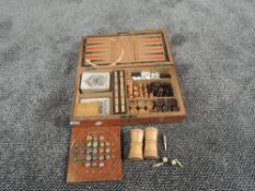 A late 19th century Games Compendium in fitted wooden case containing two sets of James English