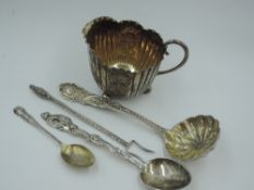 A small Victorian silver cream jug having engraved floral and scallop shell decorative panels