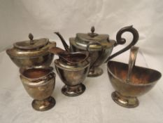 A Dutch silver five piece breakfast tea set of tapered oval form with pineapple finials, wooden