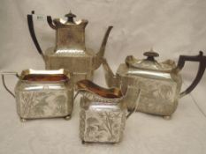 A Victorian Aesthetic movement silver four piece tea service of canted rectangular form having
