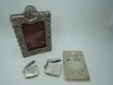 A small Victorian silver overlaid photograph frame having scroll and floral decoration and red