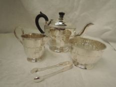 A silver three piece tea service of circular form having facetted decoration, decorative rims,