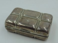 A Victorian silver lidded trinket box in the form of a parcel tied with string, with gilt