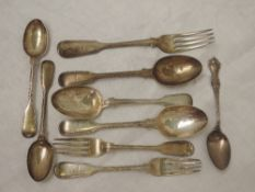 A selection of Georgian silver flatware including dessert & tea spoons and forks of fiddle back form
