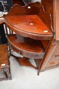 A reproduction mahogany corner wash stand