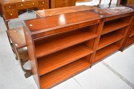 A pair of reproduction mahogany bookshelves, possibly Shaw of London