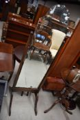 A vintage stained frame cheval mirror