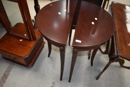 A pair of reproduction mahogany effect demi lune hall tables