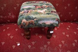 A vintage footstool with equine horse related upholstery