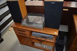 A selection of vintage hi-fi equipment in teak cabinet including NAD C422 Tuner