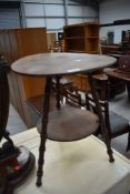 A Victorian stained frame tripod table having circular top and undertier , with simulated bamboo