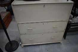 An early 20th Century bedding box with two drawers to base, deco style handles, width approx. 101cm