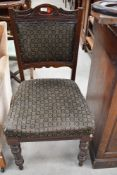 A Victorian mahogany dining chair having overstuffed seat and back