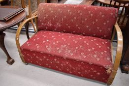 A stained frame settee in the Art Deco style with moquette upholstery
