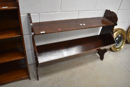 A late 19th or early 20th Century book trough/shelf, semi Gothic frame, width approx. 100cm