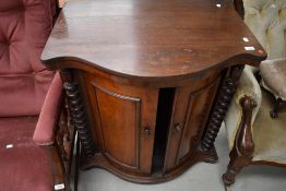 A 19th Century mahogany drinks or similar cabinet having sliding bow front doors, possibly later