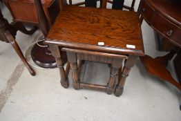 An oak Priory style nest of two tables