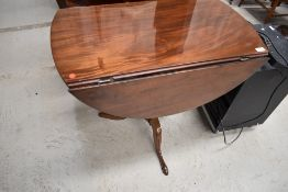 An interesting 19th Century and later pedestal table having turned column base on triple splay