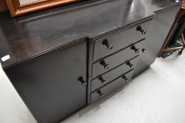 A vintage dark stained breakfront sideboard, width approx. 137cm