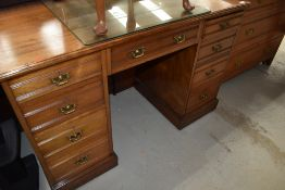 A Victorian mahogany kneehole desk or dressing table, stamped Maple & Co, width approx. 122cm