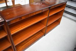 A pair of reproduction mahogany bookshelves, labelled Shaw of London