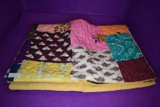 A hand made patchwork quilt or fabric throw