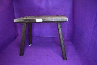 A folk art style foot or similar stool