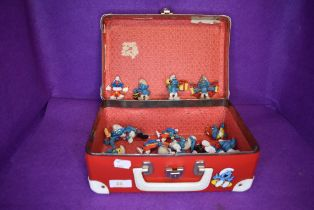 A selection of collectable toy Smurf figures including 70's 80's and 90's eras and red Smurf style