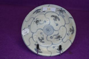 A Chinese footed dish having a celadon style glaze with blue geometric styled design on footed base