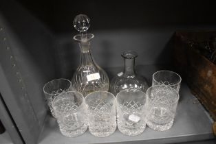 Six glass whiskey tumblers and two cut glass decanters