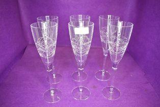 A set of six Edinburgh crystal champagne flutes in the Orrin design