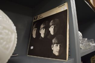 A vinyl record album in Mono the Beatles with the Beatles in fair condition